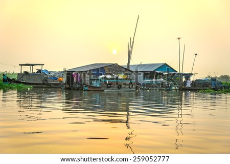 LONG XUYEN, VIETNAM - FEB 17, 2015: Small floating village covered by several boats - one of the main transportations on Mekong river near Long Xuyen floating market, An Giang province, Vietnam - stock photo