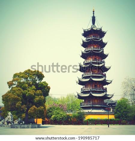 Longhua Pagoda (247 A.D.) , Shanghai, China. Retro style image. - stock photo