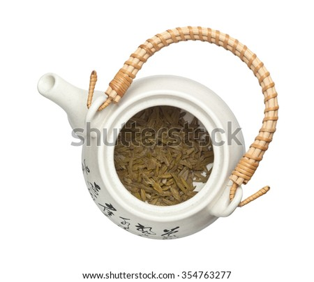 Longjing tea leaves in a teapot isolated on white background - stock photo