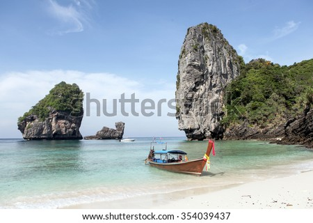 Longtail boat in nui Bay, Ko Phi Phi island, Thailand. - stock photo