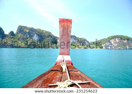 Longtail boat on crystal clear sea at tropical beach, Koh Lipe, Thailand - stock photo