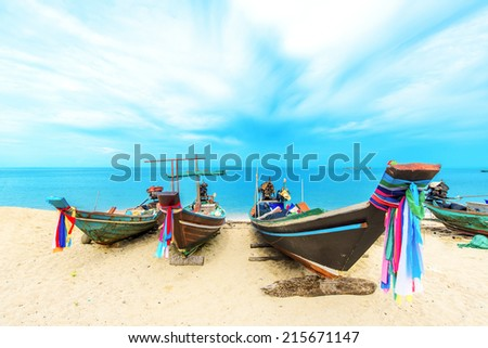 Longtail  boat on tropical beach - stock photo