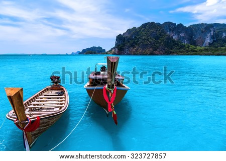 longtail boats in a tropical beach on Koh Phi Phi Island, Thailand, Asia - stock photo