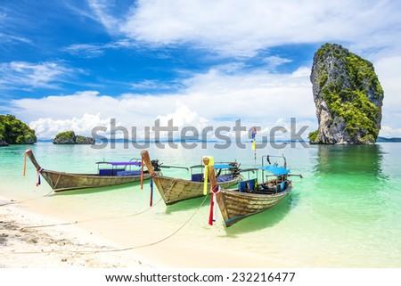 Longtale boat at the beach, Krabi, Thailand - stock photo