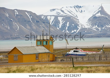 LONGYEARBYEN, NORWAY - SEPTEMBER 03, 2011: View to airport in the abandoned Russian arctic settlement Pyramiden, Norway. - stock photo