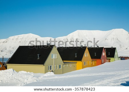 LONGYEARBYEN, SPITSBERGEN, NORWAY - APRIL 03, 2015: A small town in the far north of Europe among the snow-capped mountains. - stock photo