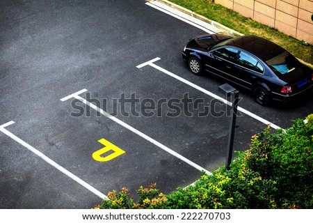 Look down empty parking spot with vegetation and shrubbery  from above - stock photo