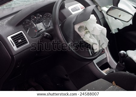 Look inside a wrecked car with airbag deployed - stock photo