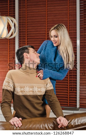 look of young couple, there are in modern apartment on sofa - stock photo