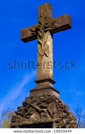 Look on gravestone and blue sky - stock photo