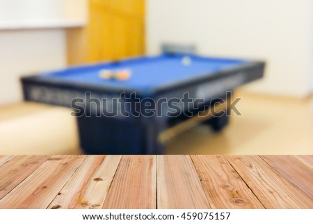 Look out from the table, blur image of billiard table as background. - stock photo