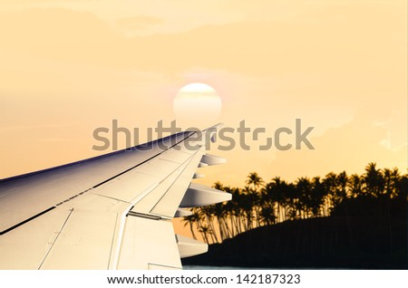 Look out of the airplane window, wing - stock photo