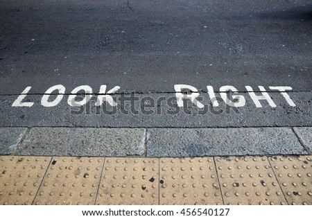 Look Right warning at a pedestrian crossing in a London street. - stock photo