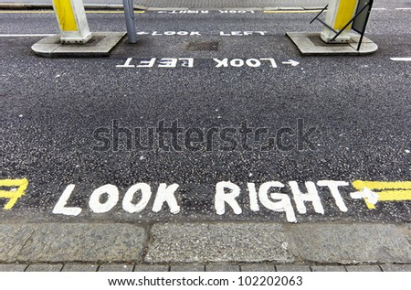 Look right warning painted on the tarmac in London, England, UK - stock photo