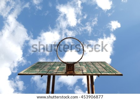 Look up old basketball hoop with blue sky - stock photo