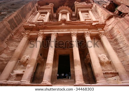 look up to the Treasury of Petra, the most famose Jordan Temple of the world. - stock photo