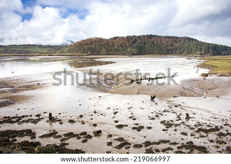 Looking across the mudflats in the estuary by Kippford harbour. Taken at Kippford, Dumfries and Galloway, Scotland, UK. - stock photo