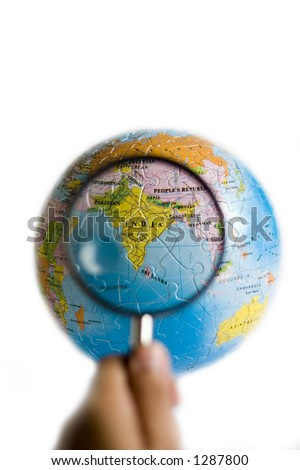Looking at India through magnifying glasses - stock photo