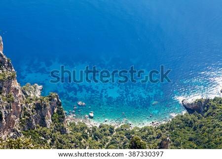Looking down a steep cliff along the Amalfi Coast in Positano Italy into the beautiful blue Mediterranean sea - stock photo