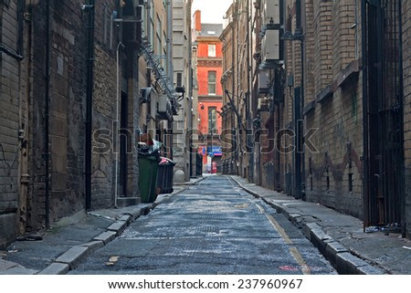 Looking down an empty inner city alleyway - stock photo