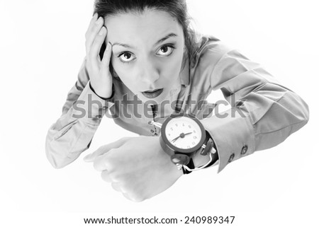 looking down at a business woman wearing a large wrist watch looking like she running late - stock photo