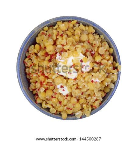 Looking down at cooked split peas with bacon and butter. - stock photo