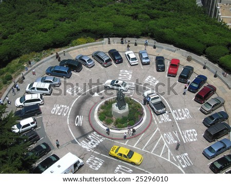 Looking down from Coit Tower at the car park as taxi drives off, San Francisco, USA - stock photo