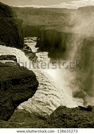 Looking down from the Gullfoss falls (stylized retro) - stock photo