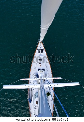 Looking down from the top of the mast of a modern sailboat moored in the warm Caribbean. - stock photo