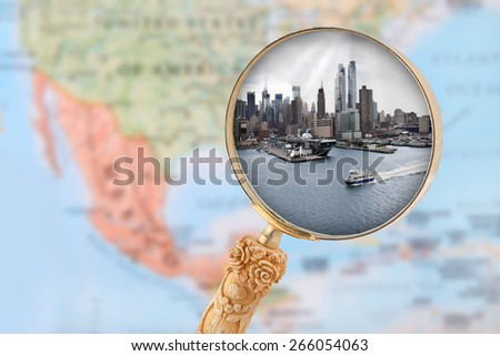 Looking in on New York City in USA with blurred map of North America in the background - stock photo