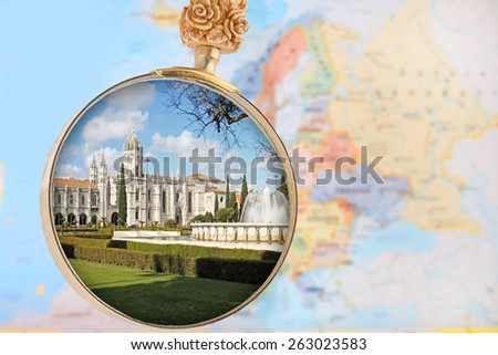 Looking in on the Mosteiro dos Jeronimos a monastery in Belem, Lisbon, Portugal with a Europe map in the background - stock photo