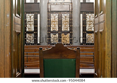 Looking into courtroom from behind judges chair - stock photo