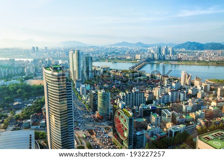 Looking out over downtown Seoul and the Han River. - stock photo