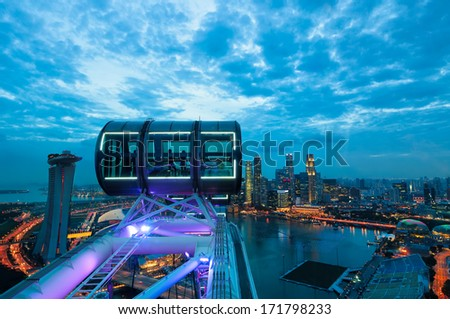 Looking out over the Singapore cityscape in early evening from the deck of the Singapore Flyer. - stock photo