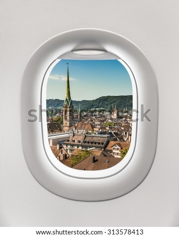 Looking out the window of a plane to the city of Zurich, Switzerland - stock photo