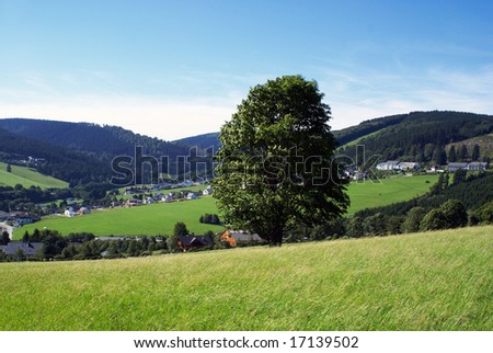 Looking over a part of a german village, seen from a mountain. - stock photo