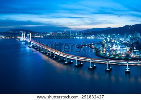 Looking over Busan Diamond bridge from top of a building. - stock photo