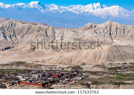 Looking over Lo Manthang toward Lo (Day) La, the south pass. - stock photo