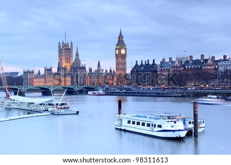 Looking over the Thames to The Houses of Parliament and Big Ben at dusk - stock photo