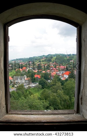 looking through dracula's castle window - stock photo
