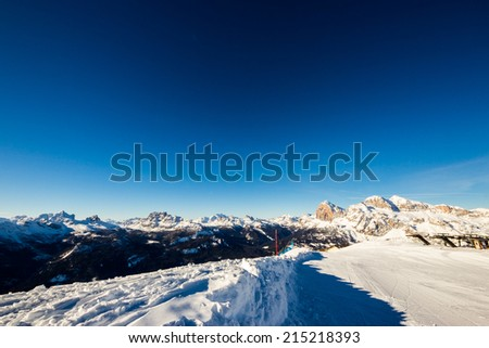 Looking to Pelmo and Civetta mountains from the peak of Faloria, Cortina d'Ampezzo, Italy. In the right of the photo we can see the Tofane group. - stock photo