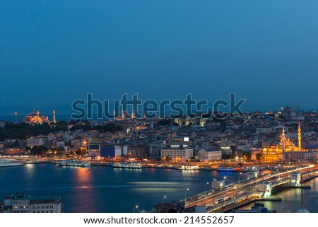 Looking toward Istanbul's old city at night, with Galata Bridge in the foreground, and the Hagia Sophia and Blue Mosque in the distance. - stock photo