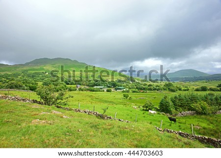 Looking towards across open countryside from Joyce's Country towards Lough Mask in Summer time, County Mayo, Ireland - stock photo