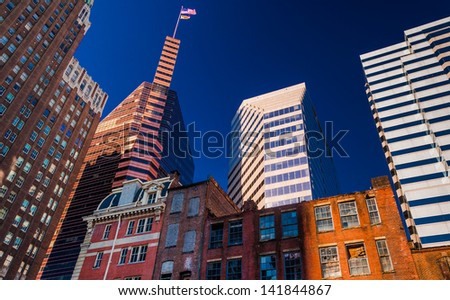 Looking up at a mix of modern and old buildings in Baltimore, Maryland. - stock photo
