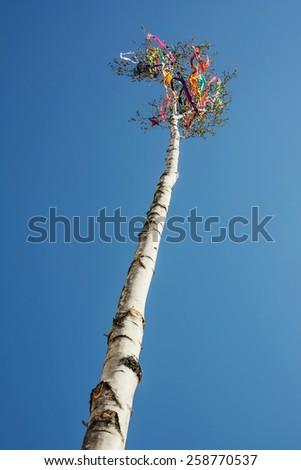 Looking up at beautiful symbolic may pole. - stock photo