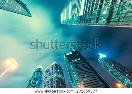 Looking up at Chicago's skyscrapers in financial district at dusk - stock photo
