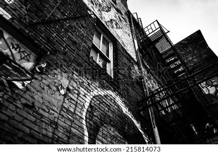 Looking up at graffiti and old staircases in Graffiti Alley, Baltimore, Maryland. - stock photo