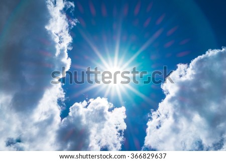 Looking up at Nice blue sky with sun beam and halo with cloudy - stock photo