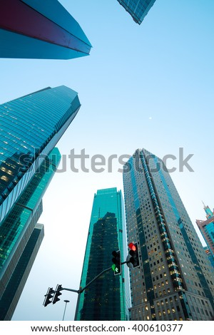 Looking up at Shanghai modern city buildings backgrounds - stock photo