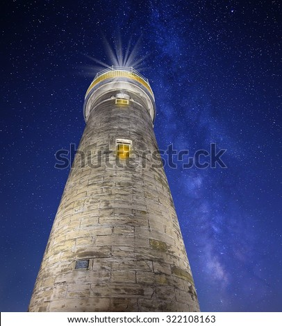 Looking up at the Grand River lighthouse in Fairport Harbor, Ohio with a beautiful night sky in the background. - stock photo
